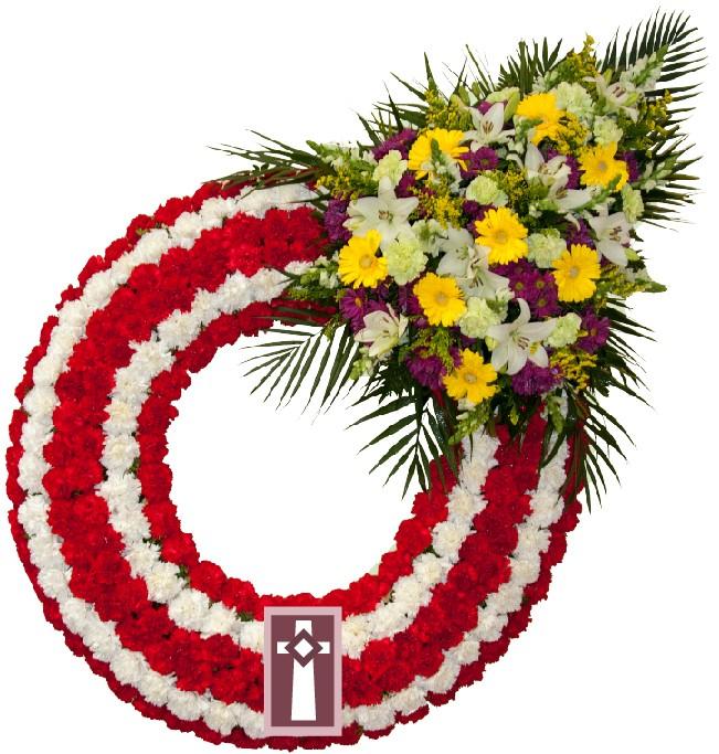 Corona. Económica, en flor natural. Dimensiones: Aro de 80cm de diámetro con un centro de flor variada.