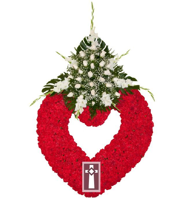 Corona. Formato Corazón, en flor natural. Dimensiones: Aro de 90cm de diámetro con un centro de flor variada