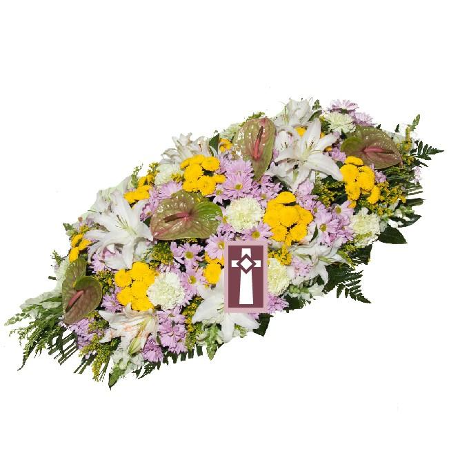 Centro. Uniforme y elegante, en flor variada. Dimensiones: 70cm largo.